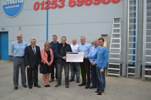 Receiving the cheque from Smithshire