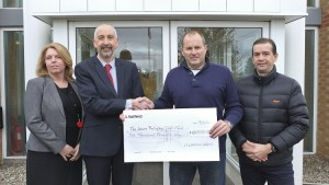 Glasdon MD Phillip Greenwood presenting the cheque to Kevin Balyckyi